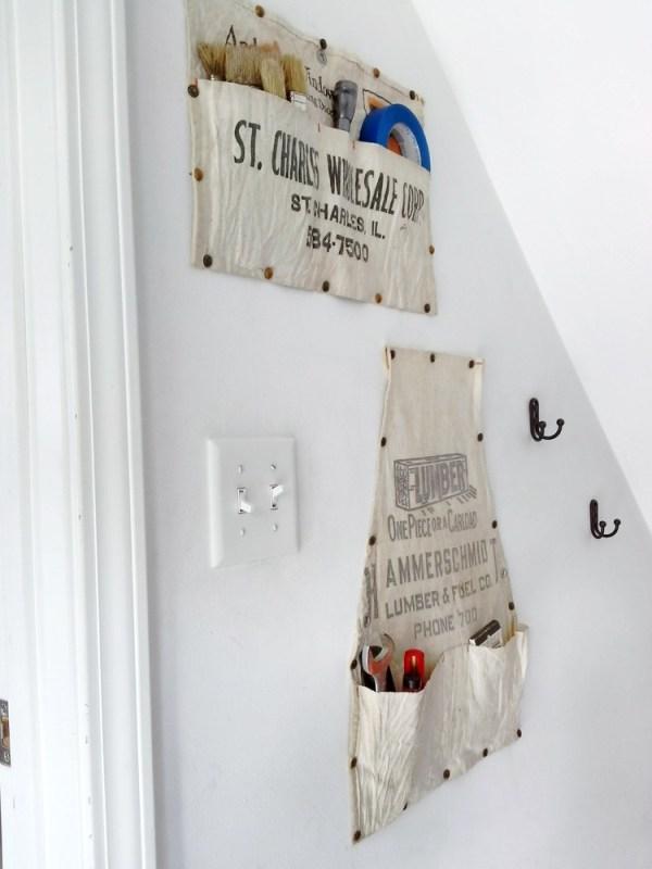 Stairway storage ideas - hanging old work aprons - StowandTellU.com
