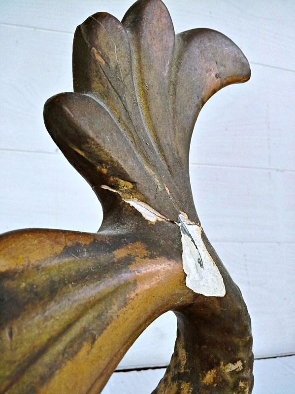 broken fin mermaid statue