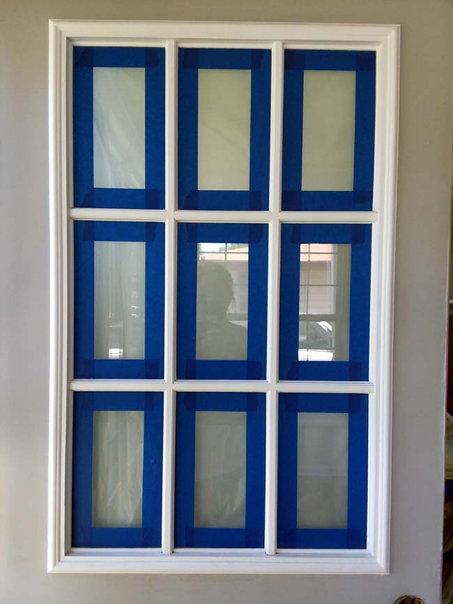 Grid Window Lites on door taped for painting | 10 Tips to Painting Grid Doors and Frosting the Glass Windows
