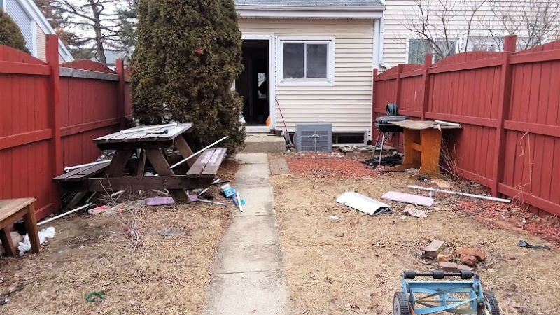 small messy backyard with clutter