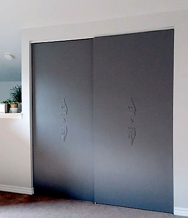 Outdated closet doors modernized with dark gray paint