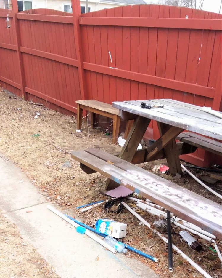 broken leaning fence post