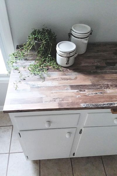 White cabinet with faux wood countertop