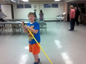 Connor sweeping the floor