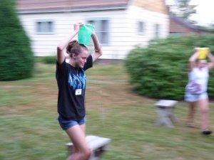 Girls balancing water on their heads