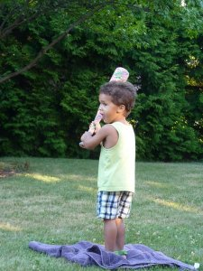 Young boy waits to hit the ball