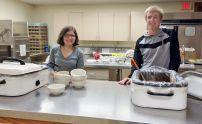 Sarah and Ellis serve soup