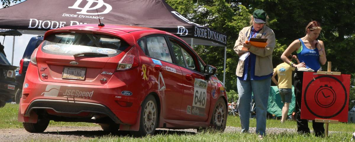 Checking the rally cars in and out of Service at Germania is just one of the many volunteer jobs at STPR. (Lori Lass)