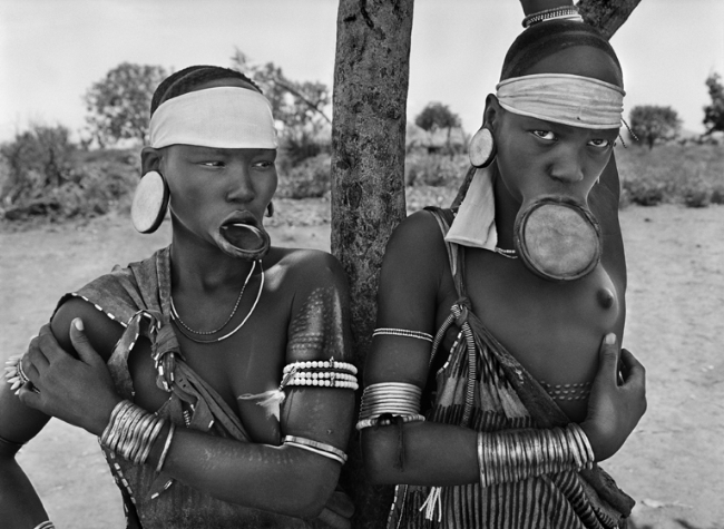 Sebastião Salgado, Mursi village of Dargui in Mago National Park, near Jinka, Ethiopia (two women with lip plates), 2007, Gelatin silver print, 50 x 60 cm/20 x 24 inches © Sebastião Salgado/Amazonas Images