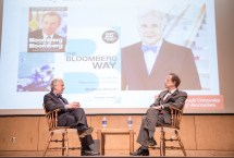 Bloomberg News Editor in Chief Matt Winkler and School of Journalism Dean Howard Schneider.