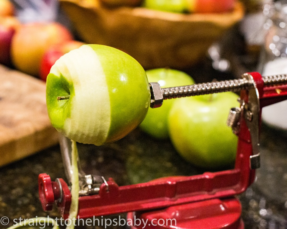 a green apple being peeled