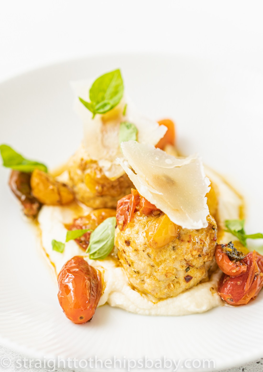 two turkey meatballs on a bed of celery root puree as part of 8 Easy & Delicious Romantic Valentine's Day Dinner Recipes