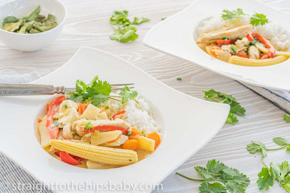 an up close look at the turkey green curry. Fresh and bright vegetables are covered in green creamy sauce over white rice