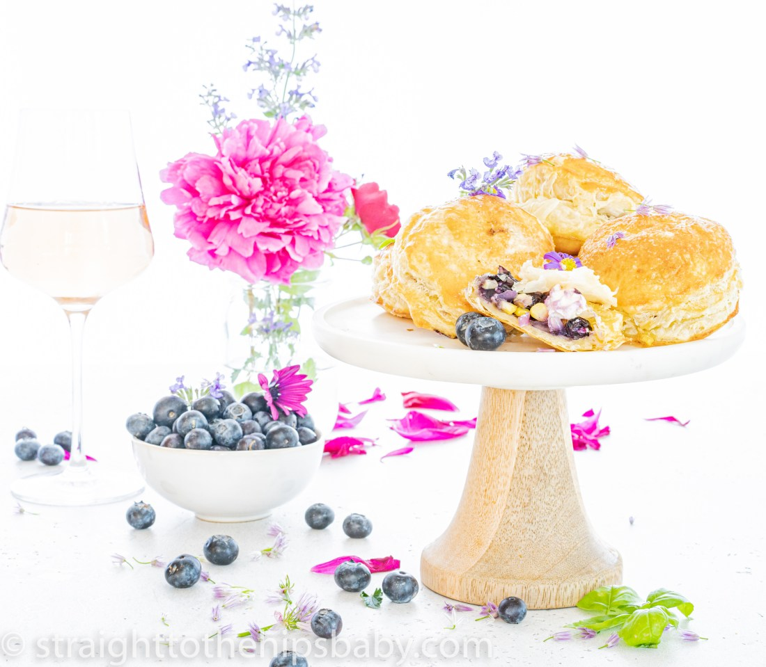 a plate of blueberry corn and goat cheese puff pastry bites