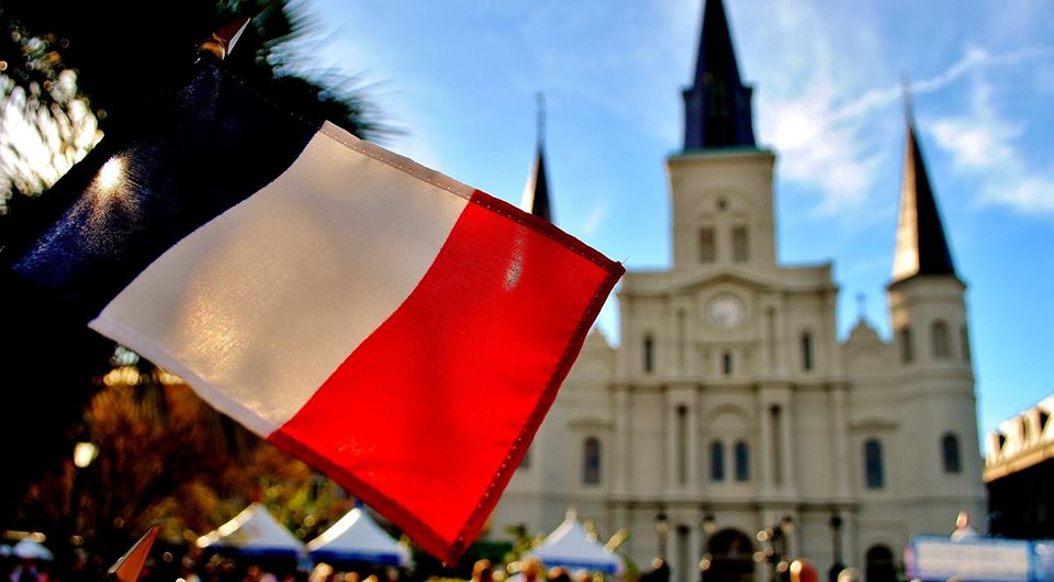 French flag in Jackson Square with St Louis Cathedral in the background