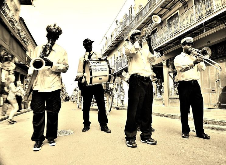 Brass band leads a 2nd line in the French Quarter of New Orleans
