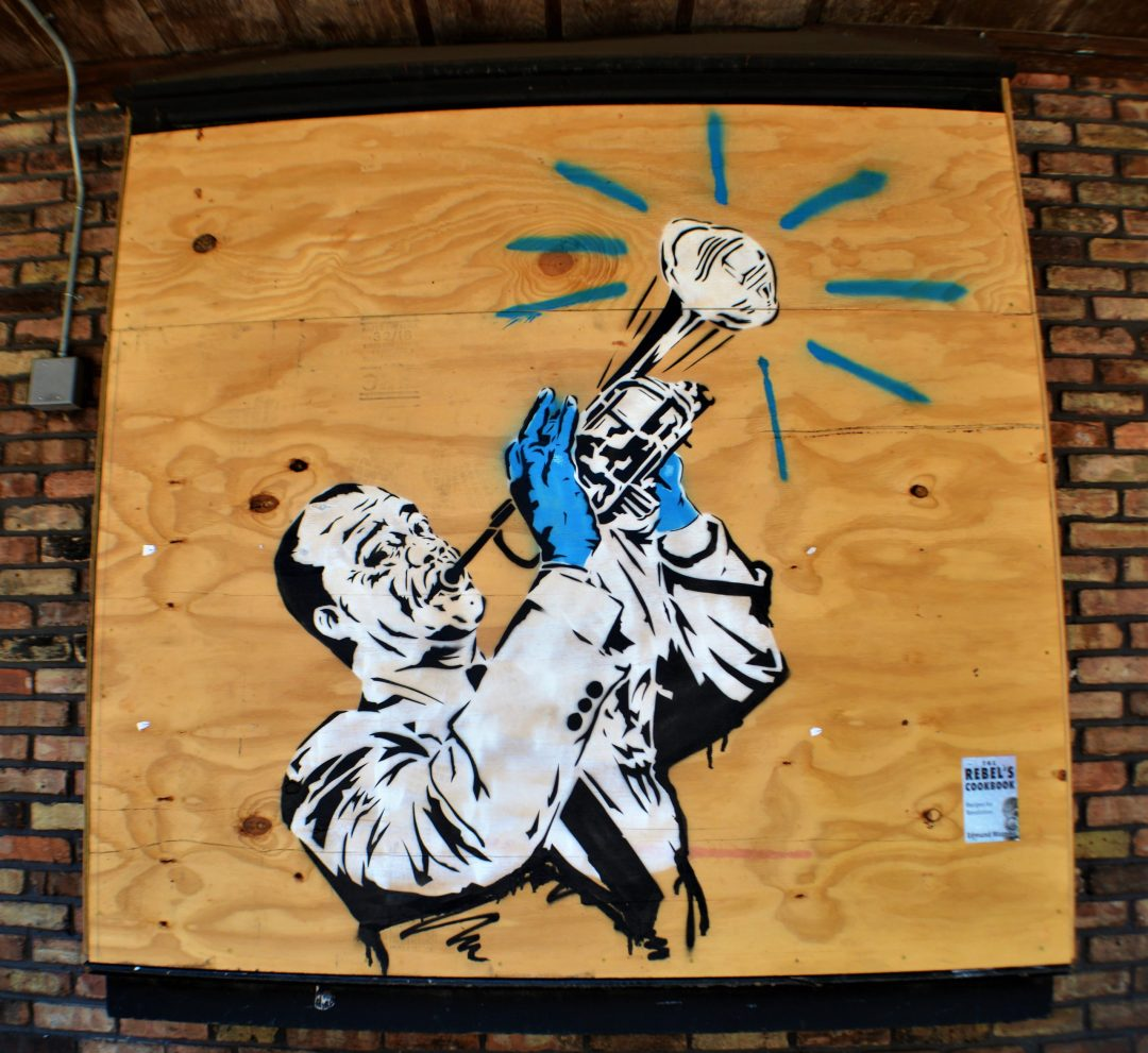 Street art of Louis Armstrong on Frenchmen's Street in New Orleans