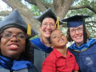 Our recent (2012) graduates, Chandra Jack (on the left), Tracy Douglas (on the right), Debbie Brock (center) with Chandra Jack's son, Jacorri.