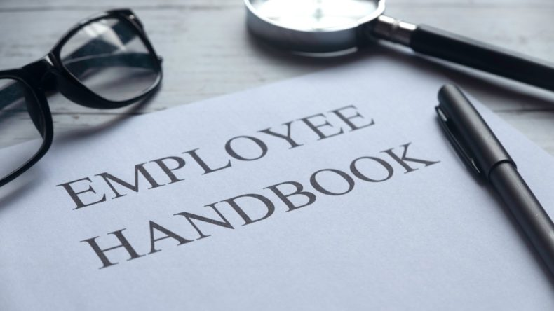 selective-focus-of-glasses-magnifying-glass-pen-and-paper-written-with-employee-handbook-on-white_t20_E0rXvX-e1604461717154-790x444