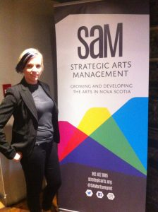 Cat MacKeigan with a SAM poster