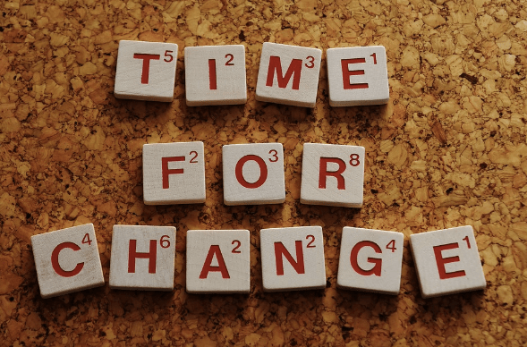 "scrabble tiles that say ""time for change"" representing new habits"