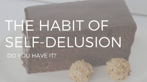 "THE TEXT ""THE HABIT OF SELF-DELUSION"" OVER A PHOTO OF A SLICE OF CHOCOLATE CAKE AND TWO TRUFFLES."