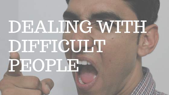 "Man with dark hair yelling and pointing his finger in anger with white text reading ""dealing with difficult people"""