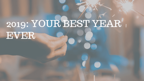 "Hand holding sparkler, with white text over reading ""2009: your best year ever"""
