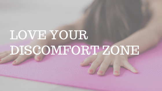 "a woman stretching on a yoga mat with the text ""love your discomfort zone"""