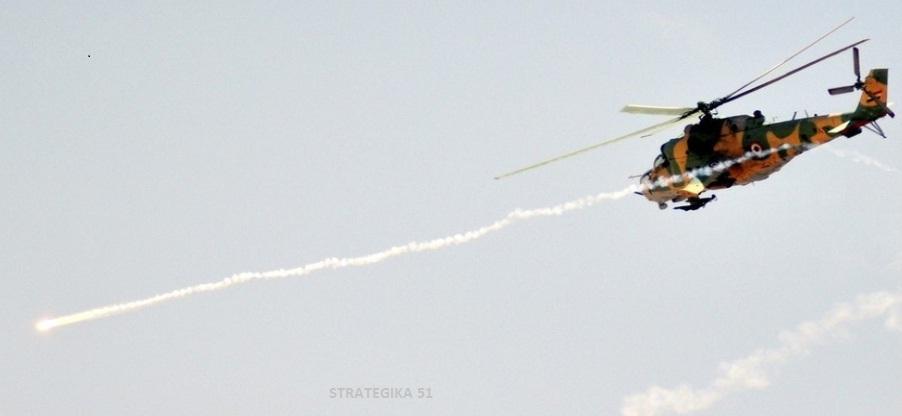 Un hélicoptère d'attaque de l'armée syrienne en action. Cette arme s'est révélée d'une redoutable efficacité contre les bastion rebelles, malgré les menaces croissantes posées par les missiles SAM et les canons antiaériens aux mains des rebelles.