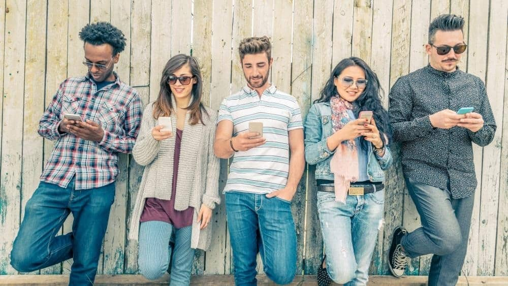 Picture of five people with phone