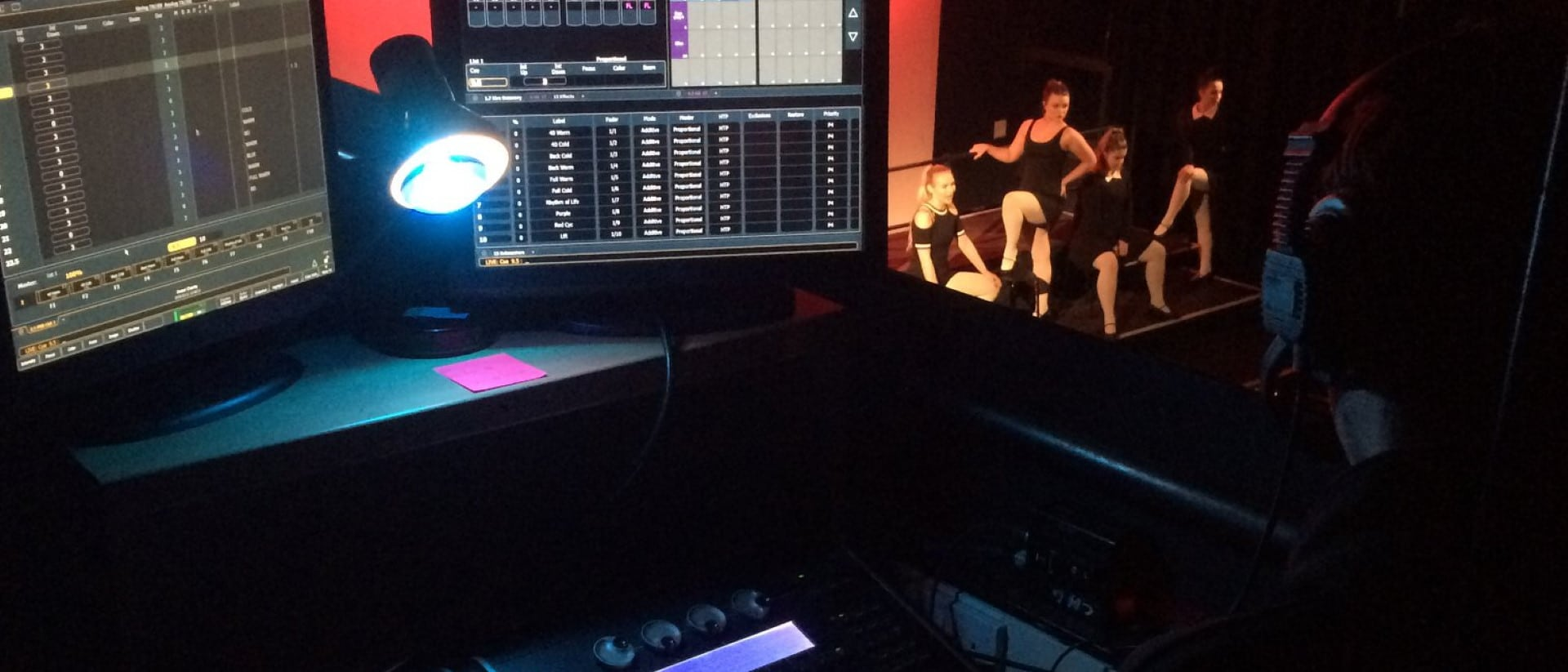 Student controls stage lighting.