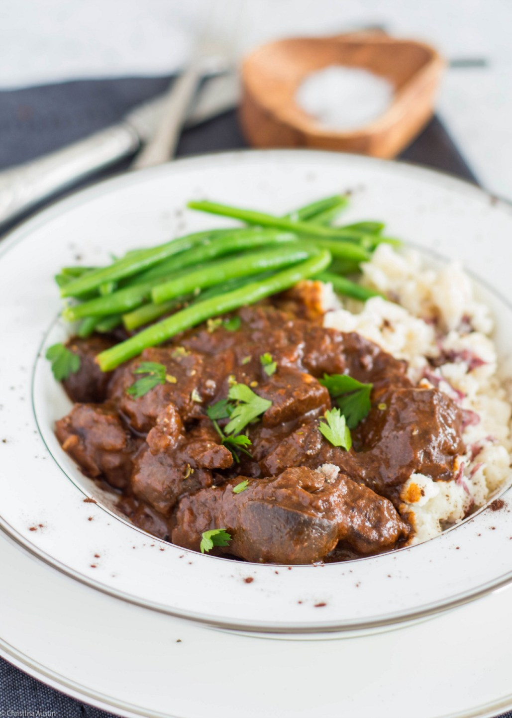 A rich beef and mushroom stew with traditional flavours, perked up with the savoury addition of cocoa powder.