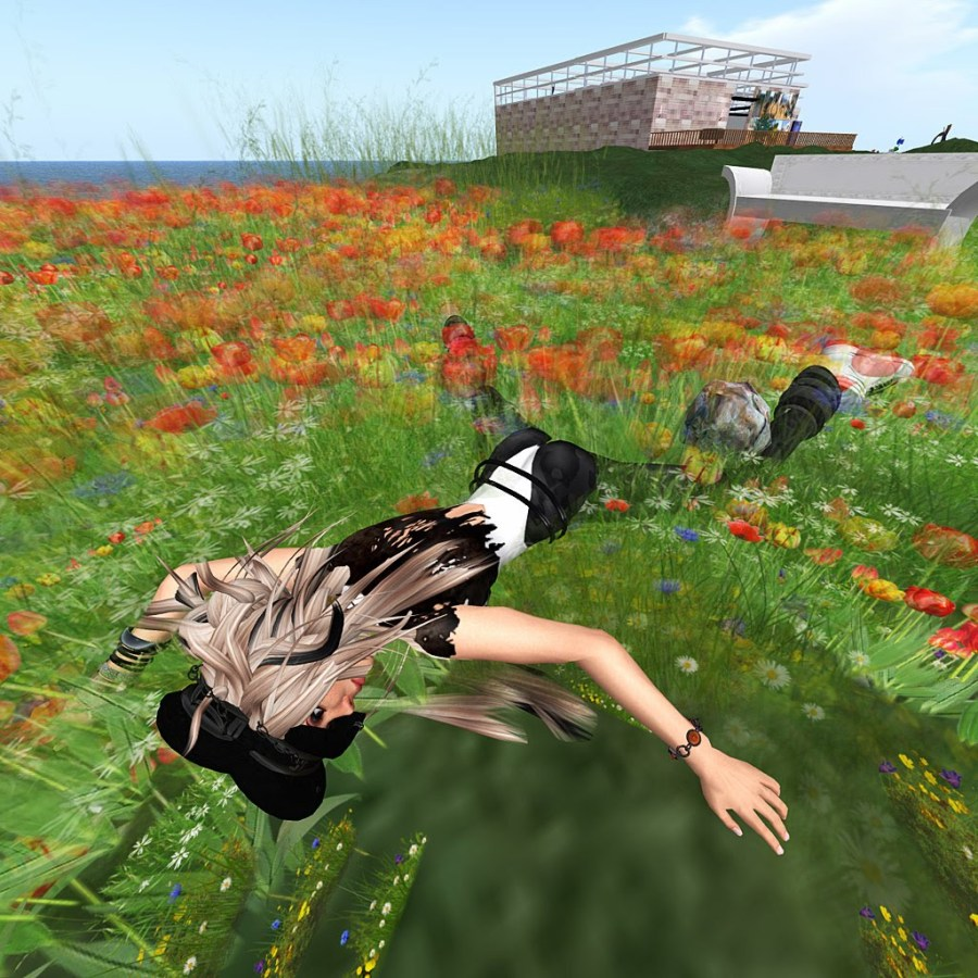 Avatar Corpse: Vanessa Blaylock lying prostrate in a field of flowers.