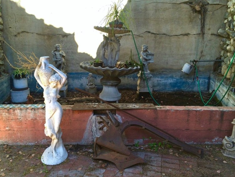 A janky fountain in between one of the residences on the property.