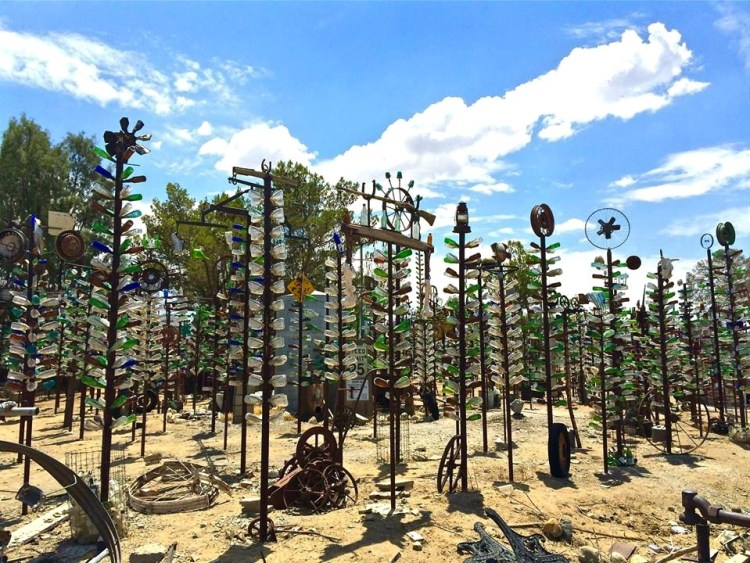 What does one do when left with thousands of colored glass bottles? Begin a massive recycling effort, or perhaps an obscure outdoor art gallery? Elmer Long decided on both after becoming the sole beneficiary of a massive bottle collection.