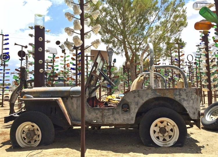 Each way you turn, there's always something new to see, including this Jeep in the middle of a bottle tree forest.