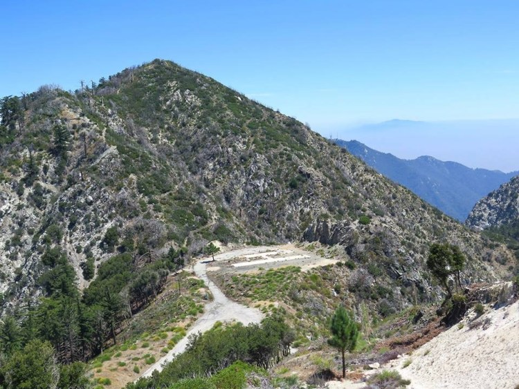 Looking down from where the antennas are, one can see the former missile launching site below. San Gabriel Peak is above that.