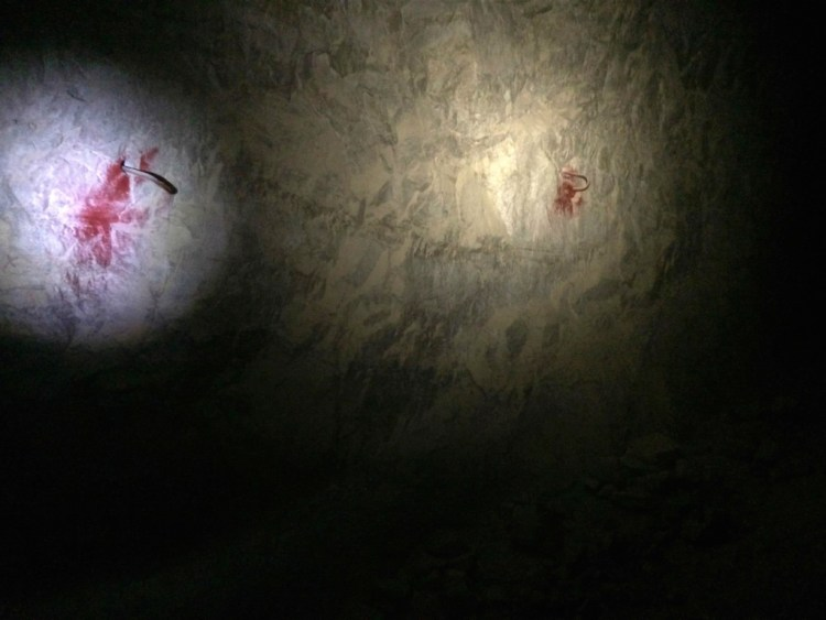 Not what you were thinking but still a rather spooky sight when you're all alone, 2000 feet inside a pitch black abandoned mine on Halloween. The red markings highlight possible dangers for those who drive through with larger vehicles.
