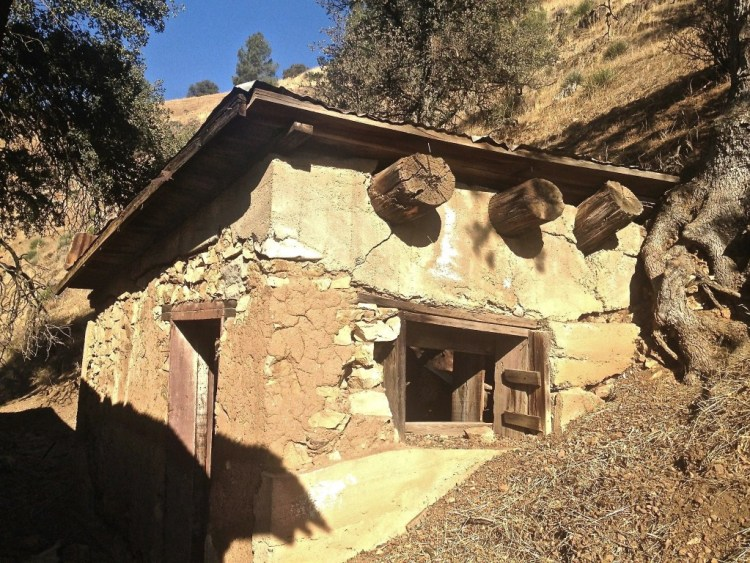 A well insulated adobe structure located behind the kitchen that was most likely used for food storage.
