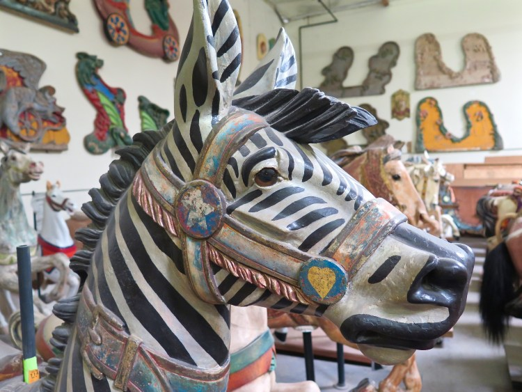 Romance Side - The most highly-decorated side of a carousel horse. Most carousel horses, especially outside-row horses, carried much more decoration on the side of the horse that was going to be seen by the public than on the side that faced towards the center of the carousel.