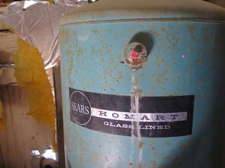 This section was usually the place where they stashed away the things they didn't want the general public to see when they stopped by for an unannounced tour. Like this Sears branded water heater...