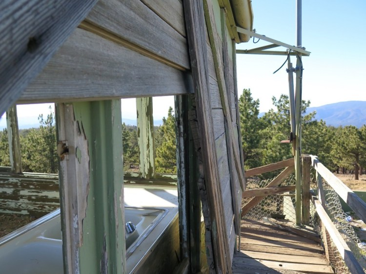 "To permit 360 degree observation, the main observation deck of the lookout (called the ""cab"") was designed with large windows on all sides..."