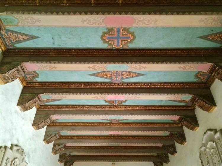 The interior ceiling decoration is by John B. Smeraldi. Smeraldi was also working on the ceilings at the Biltmore Hotel downtown while working on the church.