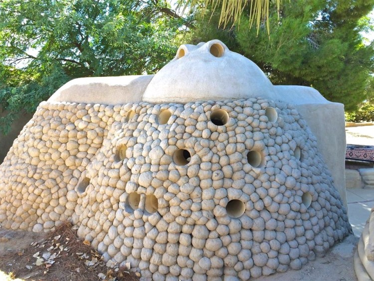 The small holes not only offer protection from the outside but also aid in keeping the dome naturally cool on the inside by cutting down on direct sunlight heating it up and also providing better circulation.