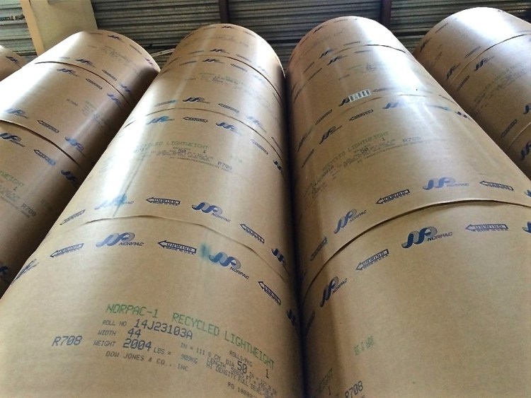 Each roll of paper weighs over 2000 lbs and costs the Times anywhere between $600-700.