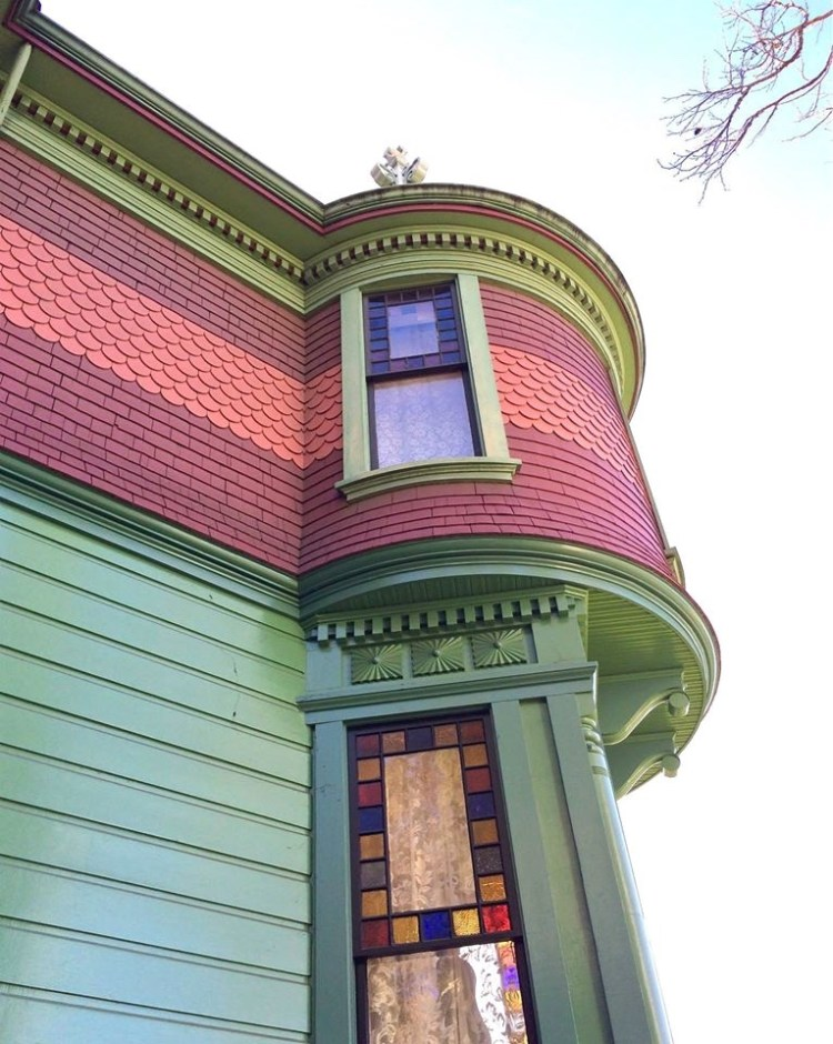 """This multi-colored, turreted, upper-middle class house has been called """"picturesque eclectic,"""" and is a mixture of the Queen Anne and Eastlake styles of architecture."""