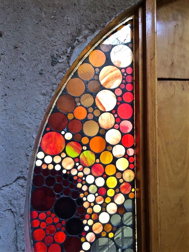 Stained glass doorway framing Paolo Soleri's old office.