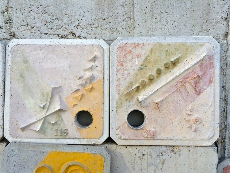 Ceramic tiles that were originally made to decorate the outside of a future building project lie on a path along our tour.