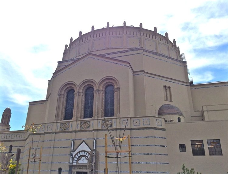 The immense Byzantine revival dome stands at 100 feet in diameter with its top 135 feet from the street. Its base is flanked by 28 buttresses, or small towers, rising from the ring girder for support. The original dome was topped in white ceramic which ended up leaking. Copper was installed shortly after.